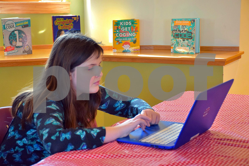 Ten-year-old Jael Keys of Sycamore uses a laptop to learn more about computer programming and coding during an introductory meeting of Girls Who Code on Saturday at the Sycamore Public Library. The newly formed group is part of the nonprofit organization Girls Who Code, which has more than 40,000 members in all 50 states.