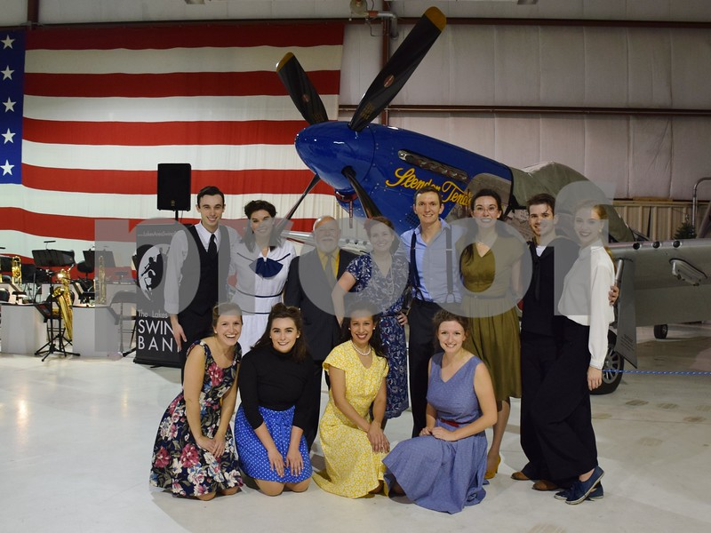 "The cast of ""I'll be Seeing You,"" an original musical that opens with a USO dance in Chicago, poses for a photo during the USO Hangar Dance held at DeKalb Taylor Municipal Airport on Saturday. The musical is part of Overshadowed Theatrical Productions in Medinah."