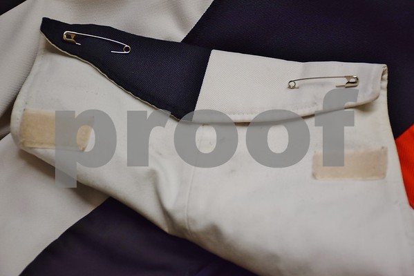 Most of the DeKalb Marching Barbs' heavy wool uniforms have tears at seams, pilling from where equipment rubs, missing buttons and irremovable stains. Pants have countless hemlines, broken zippers and worn-out leg bottoms. This jacket's fold is held together with two safety pins.