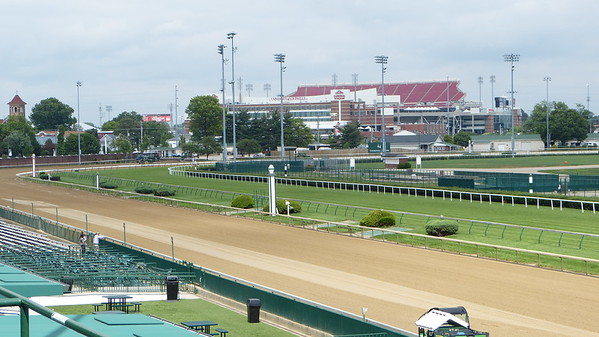 The stretch run at Churchill Downs -- that's the University of  Louisville stadium in the background