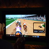 JT playing the horse race game at the Kentucky Derby Museum