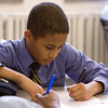Rashaan carefully revises an essay in his seventh-grade Language Arts class.