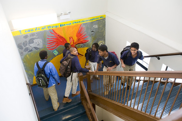 Chicago Jesuit Academy sixth and seventh graders share a laugh as they head up to their next class.
