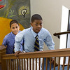 Seventh graders Javier and Rashaan head upstairs to their next class.