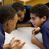 Tommie (right) helps his sixth-grade classmates Julian, Kenneth, and Mark plan their strategy for a group project.