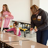 Faculty, students, and even some little ones pitch in to get Pacific Garden Mission ready for visitors.