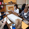 Students prepare mailings to churches that promote Christian Peacemaker Teams.
