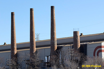 Smokestacks from World War II ammunition plant near Southwest Boulevard, St. Louis, MO (demolition of stack on the right is already in progress)