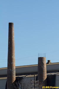 Smokestacks from World War II ammunition plant near Southwest Boulevard, St. Louis, MO (demolition of stack on the right is already in progress; two additional stacks to the left are not shown in this image)