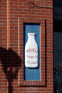 Left Milk bottle in the facade of the old Pevely Dairy building on Grand Blvd.