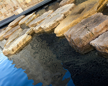 Large fountain stones and reflections