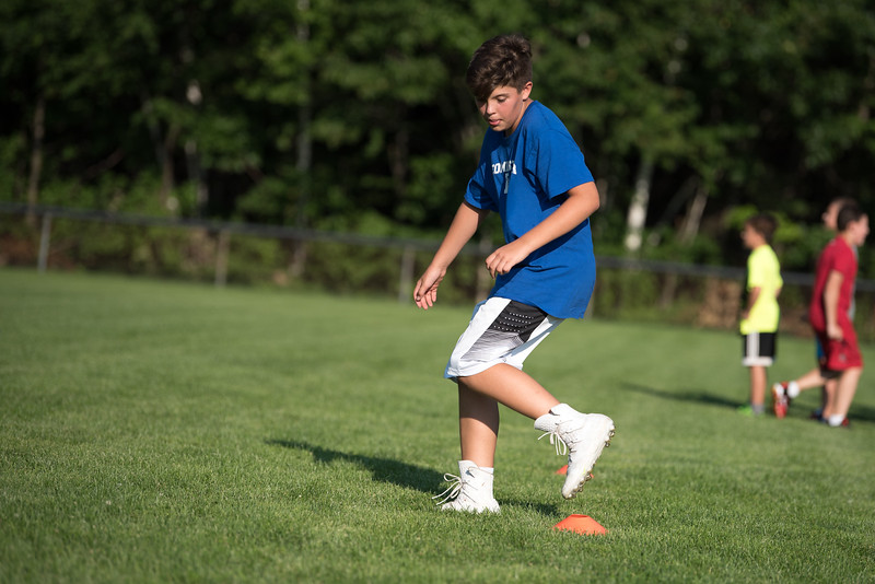 14 year old Jacob Tocci performs a drill at the Mike Austin Memorial Football Camp which is free to all boys and girls between the ages of 5 and 14 at the Leominster Pop Warner football field on July 31, 2017.  Mike Austin passed away in May of 2017 leaving behind 35 plus years of dedication to a number of youth athletic programs in Leominster.  SENTINEL & ENTERPRISE JEFF PORTER