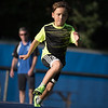 9 year old Mateo Ferreria runs through the ladders at the Mike Austin Memorial Football Camp which is free to all boys and girls between the ages of 5 and 14 at the Leominster Pop Warner football field on July 31, 2017.  Mike Austin passed away in May of 2017 leaving behind 35 plus years of dedication to a number of youth athletic programs in Leominster.  SENTINEL & ENTERPRISE JEFF PORTER