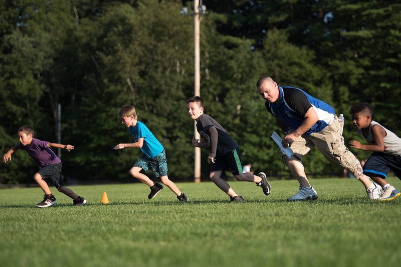 Kids run during a drill at the Mike Austin Memorial Football Camp which is free to all boys and girls between the ages of 5 and 14 at the Leominster Pop Warner football field on July 31, 2017.  Mike Austin passed away earlier this year leaving behind 35 plus years of dedication to a number of youth athletic programs in Leominster.  SENTINEL & ENTERPRISE JEFF PORTER