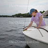 Sailing instructor Maddie Vance cleans a sailboat Thursday, June 23, 2016, at the John R. Turney Sailing Center docks. The instructors were cleaning and rigging the boats in preparation for the start of the season.