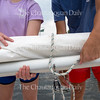 Sailing instructors Maddie Vance, left, and Nick Rowe secure a sail Thursday, June 23, 2016, at the John R. Turney Sailing Center docks. The instructors were cleaning and rigging the boats in preparation for the start of the season.