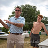 Sailing Director Kirk Kelly, left, speaks to the sailing instructors, including his son Thomas Kelly, right, Thursday, June 23, 2016, at John R. Turney Sailing Center. The instructors were cleaning and rigging the boats in preparation for the start of the season.