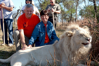 Mike and Nancy getting a photo with the lion. No we were not pulling on his hair. Look at the animal photos in this gallery, you can see they are still on the wild side but they have excellent trainers standing around
