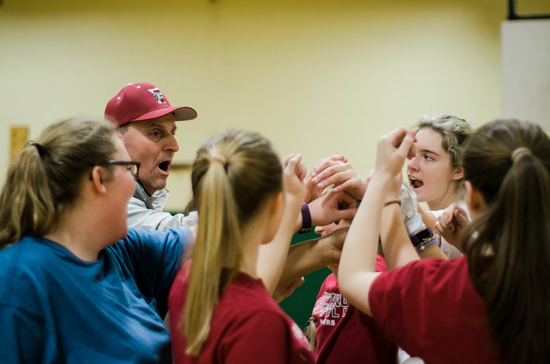 Coach Mike Pelland and the Fitchburg High softball team huddle up after practice on Friday, March 24, 2017. SENTINEL & ENTERPRISE / Ashley Green