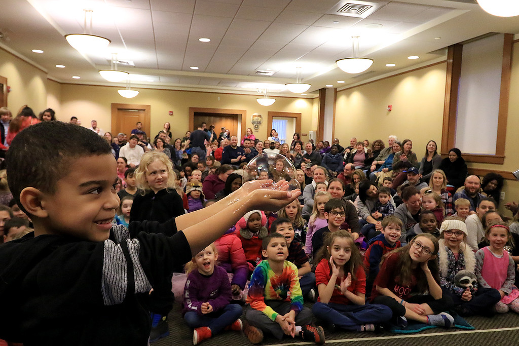 . Mike Dorval of Northboro known as Mike the Bubbleman visited the Leomisnter Public Library on Saturday, January 5, 2019 to a packed house of kids and parents. Syier Faison, 6, of Fitchburg learns how to catch a bubble without popping it during the show. SENTINEL & ENTERPRISE/JOHN LOVE