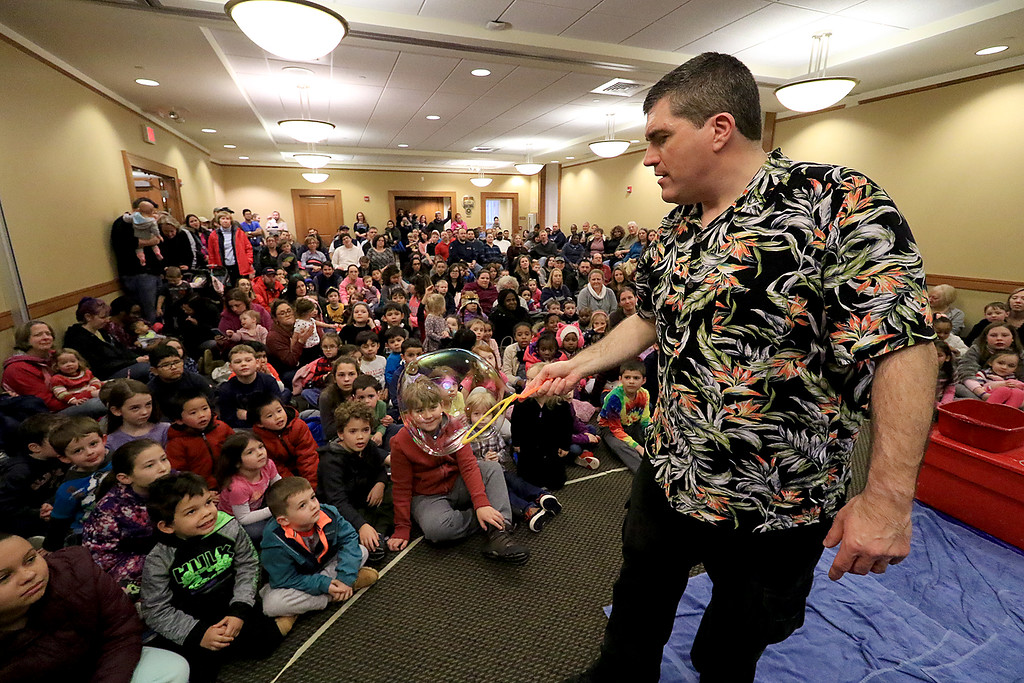 . Mike Dorval of Northboro known as Mike the Bubbleman visited the Leomisnter Public Library on Saturday, January 5, 2019 to a packed house of kids and parents. Mike does some tricks with the bubbles as he talks about them. SENTINEL & ENTERPRISE/JOHN LOVE