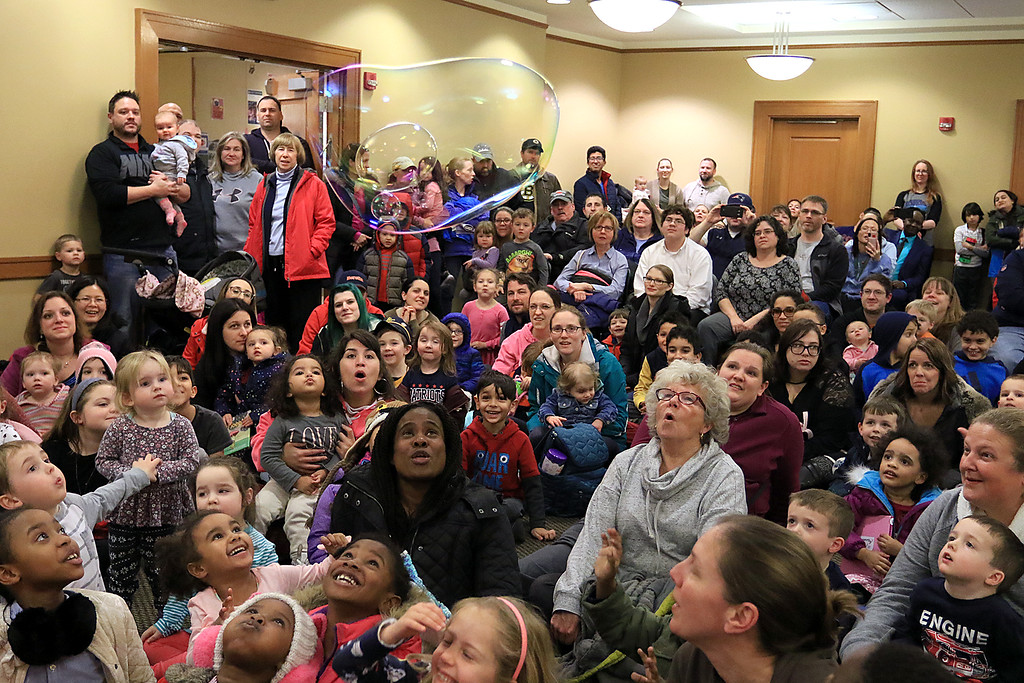 . Mike Dorval of Northboro known as Mike the Bubbleman visited the Leomisnter Public Library on Saturday, January 5, 2019 to a packed house of kids and parents. Some of the audience members try and keep this bubble in the air by blowing at it during the show. SENTINEL & ENTERPRISE/JOHN LOVE