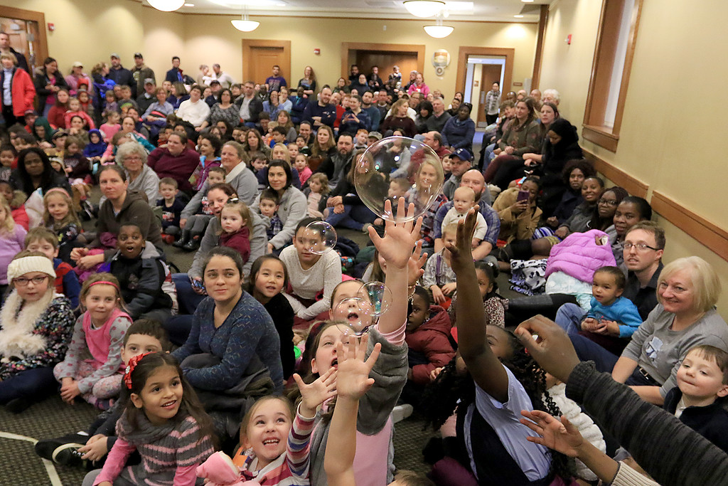 . Mike Dorval of Northboro known as Mike the Bubbleman visited the Leomisnter Public Library on Saturday, January 5, 2019 to a packed house of kids and parents. Kids reach for some bubbles as they passes over them during the show. SENTINEL & ENTERPRISE/JOHN LOVE