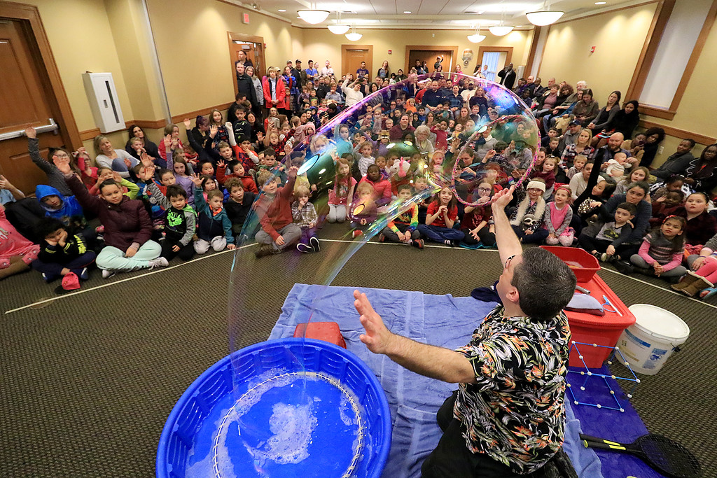 . Mike Dorval of Northboro known as Mike the Bubbleman visited the Leomisnter Public Library on Saturday, January 5, 2019 to a packed house of kids and parents. Mike makes a big bubbles to show the kids and parents that they can see a rainbow in it. SENTINEL & ENTERPRISE/JOHN LOVE