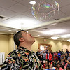 Mike Dorval of Northboro known as Mike the Bubbleman visited the Leomisnter Public Library on Saturday, January 5, 2019 to a packed house of kids and parents. Mike makes some bubbles inside a bubble during his show. SENTINEL & ENTERPRISE/JOHN LOVE