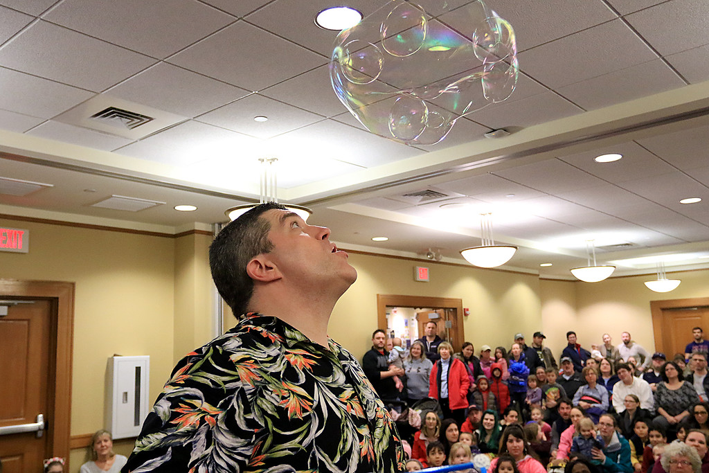 . Mike Dorval of Northboro known as Mike the Bubbleman visited the Leomisnter Public Library on Saturday, January 5, 2019 to a packed house of kids and parents. Mike makes some bubbles inside a bubble during his show. SENTINEL & ENTERPRISE/JOHN LOVE