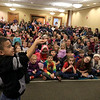 Mike Dorval of Northboro known as Mike the Bubbleman visited the Leomisnter Public Library on Saturday, January 5, 2019 to a packed house of kids and parents. Syier Faison, 6, of Fitchburg tries to catch a bubble without popping it during the show. SENTINEL & ENTERPRISE/JOHN LOVE