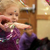 Mike Dorval of Northboro known as Mike the Bubbleman visited the Leomisnter Public Library on Saturday, January 5, 2019 to a packed house of kids and parents. An young audience member puts her hand through some soap film without popping it during thee show. SENTINEL & ENTERPRISE/JOHN LOVE