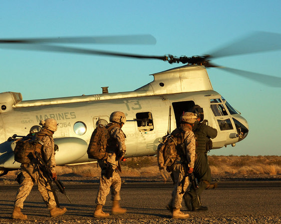 U.S. Marines prepare to board CH-46 Sea Knight helicopters for a heliborne raid during WTI 2-06