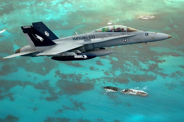 F/A-18D over the reef at Saipan