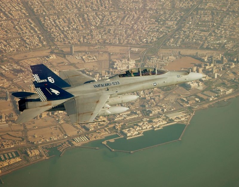 F/A-18D from VMFA(AW)-533 flies over Kuwait City during Operation Iraqi Freedom.