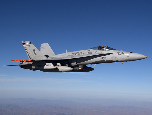 an FA-18 from VMFA-115 flies over the California desert during WTI 2-07