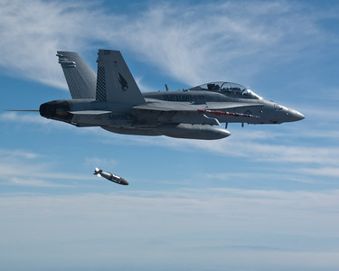 F/A-18D from VMFA(AW)-533 releases a Joint Direct Attack Munition (JDAM) over the Chocolate Mountain range complex.