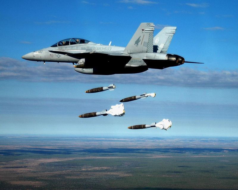 F/A-18D from VMFA(AW)-533 delivers 4 Mk-83 bombs on a target in Australia during the squadron's UDP in 2004-2005.