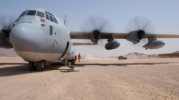 "A KC-130J from VMGR 352 awaits cargo at Farah, Afghanistan.  Farah is a dirt-strip airfield located in western Afghanistan, supporting ISAF operations in the ""wild, wild west"" of the country."