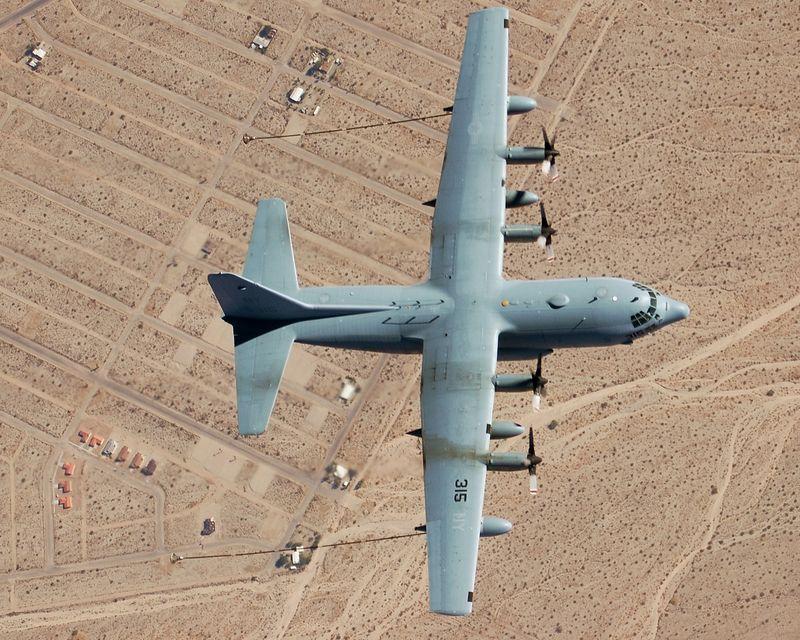 A U.S. Marine Corps KC-130 preparing to refuel aircraft over the California desert during WTI 1-06.