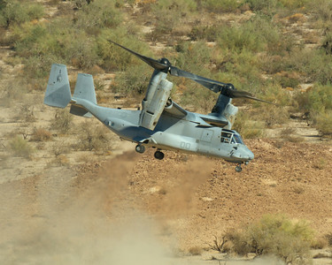 An MV-22B Osprey lifts from the California Desert during Weapons and Tactics Instructor course 1-08.  The Osprey is extracting Marines during Assault Support Tactics 1, a live-fire battalion heliborne assault into the Chocolate Mountain ranges.