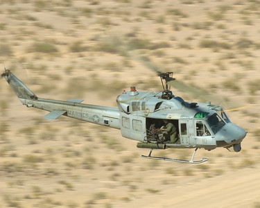 A UH-1N Huey conducting Close Air Support during Weapons and Tactics Instructor course 2-07.  The Huey was providing CAS during a heliborne raid conducted in the Final Exercise (FINEX) for WTI 2-07.