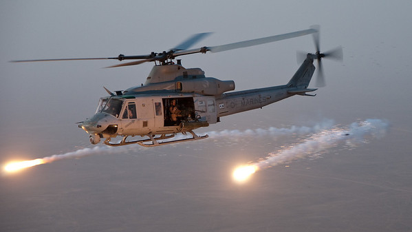 A UH-1Y dispenses flares while the crew checks the aircraft's combat systems prior to starting a combat mission in Helmand Province, Afghanistan.