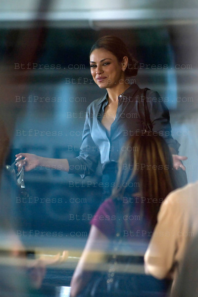"""Mila Kunis during the set of """" Friends with Benefits """" co-star Justin Timberlake, in LAX airport,California on September 14, 2010."""