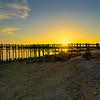 Sunset behind the gulf Beach Pier