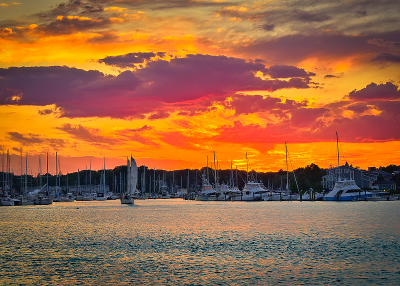 Warm skies and boats in harbor