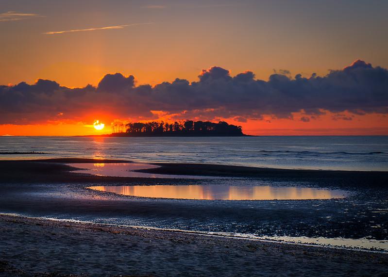 Golden morning light over Charles Island