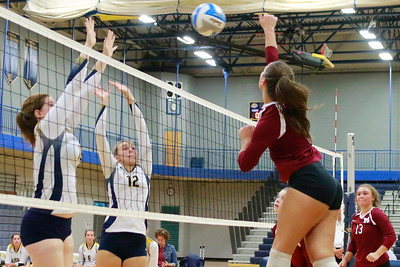 After a slow start the South Lyon volleyball teamed picked up some steam to take a straight set victory over Milford 25-20, 25-21, and 25-17 Wednesday night in Lakes Valley Conference action. (Oakland Press photo by Timothy Arrick)