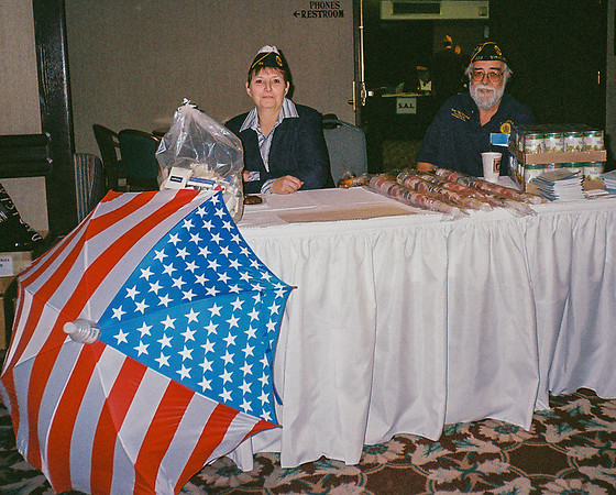 Lynn and Homeless Committee members man Committee Booth at conferences conduction fund-raising activities.