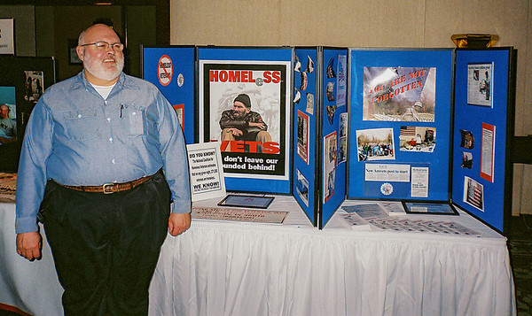 A member of the Hoosier Veterans Assistance Foundation, located in Indianapolis, mans a booth at one of the Department Conferences.